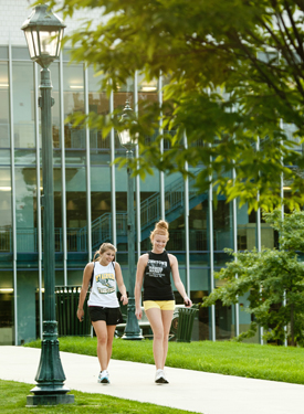 Students walking from the Mary Kintz Bevevino Library