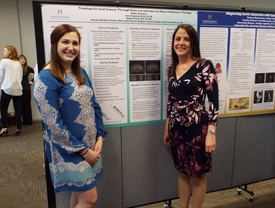 Katie Santoro poses for a photo with Gina Capitano, M.S.,R.T. (R) after presenting her research on Treating Cervical Caner Through External and Internal Beam Radiation Therapy