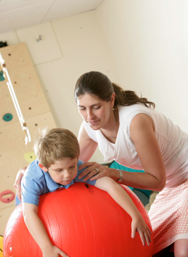 Physical Therapy student with pediatric patient
