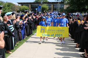 Members of the first-year class process to convocation.