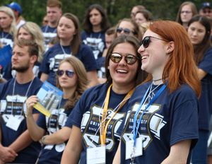 First-year students enjoy a laugh together as the rest of the 412-member first-year class processes into the Wells Fargo Amphitheater.