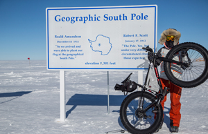 Polar adventurer Eric Larsen poses for a picture in front of the Geographic South Pole sign in Antarctica. Larsen will make two free presentations, 'A Conversation on Global Warming and the Arctic Ice Cap' and 'On Thin Ice,' for the public and Misericordia University campus community on Monday, Nov. 4.