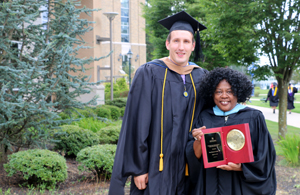 Adam Grezch '13, '17, president of the Alumni Association, presents Vera Cornish '93, M.S., with the Mother Mary Catharine McGann Alumni Achievement Award.
